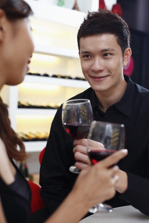 Young couple enjoying wine together photo