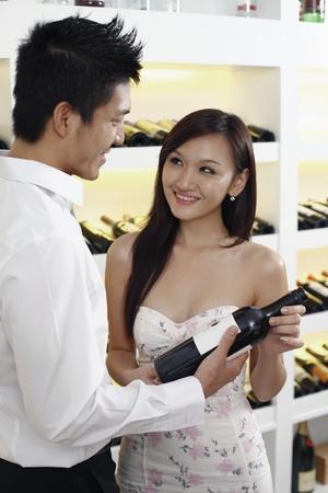 Young couple choosing wine photo