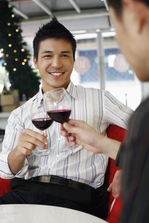 Men toasting red wine photo