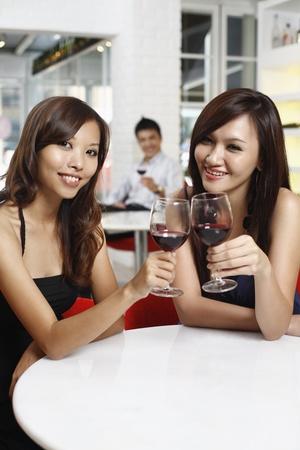 Women toasting wine photo