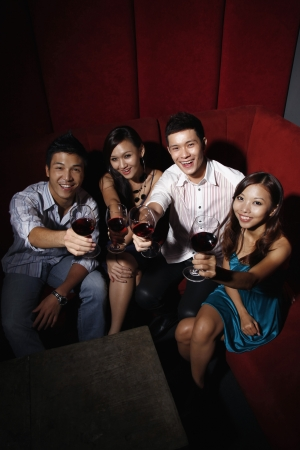 Friends toasting wine Stock Photo