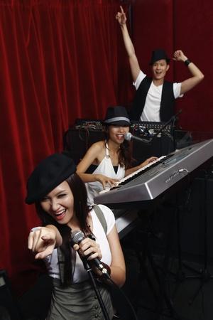 jamming: Man and women jamming in studio