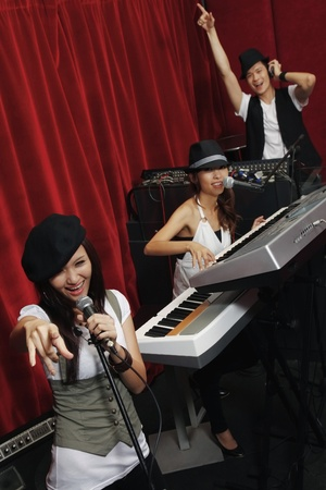 Man and women jamming in studio photo