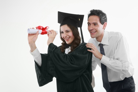 Graduate and man looking through a scroll photo