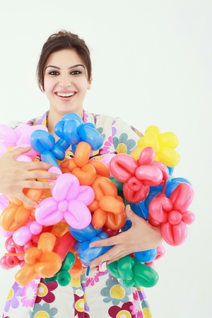 armful: Woman with an armful of sculpted balloons