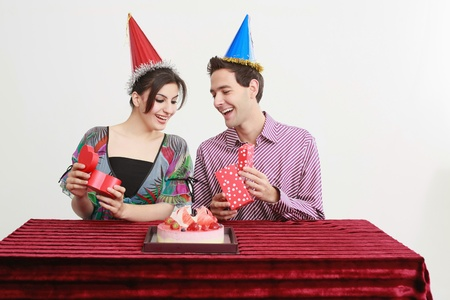 Man and woman looking at each others presents photo