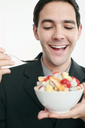 Businessman with a bowl of fruits photo