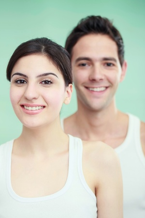 Man and woman in sleeveless tops photo