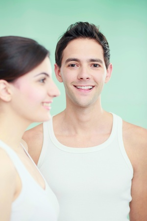 Man and woman in sleeveless tops, smiling Stock Photo - 8536997