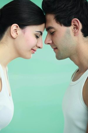 Man and woman touching foreheads photo