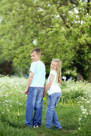 Boy and girl holding hands in the park Stock Photo - 8536374