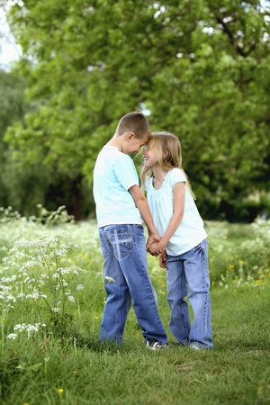 Boy and girl holding hands in the park Stock Photo - 8536277