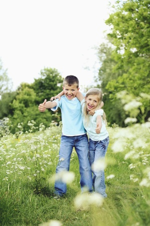 Boy and girl showing thumbs up Stock Photo - 8536412