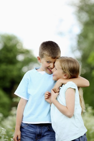 Boy with arm around girl's shoulders Stock Photo - 8536712