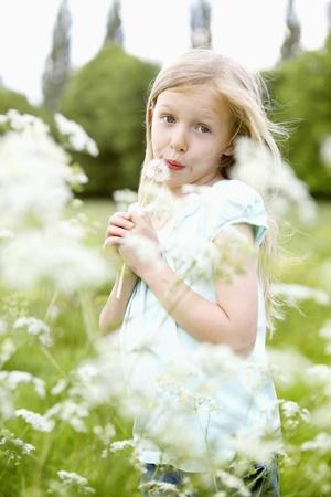 Girl playing with dandelion Stock Photo - 8536855