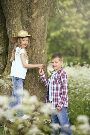 Boy giving girl flowers photo