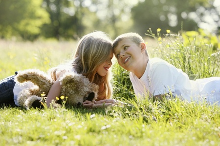 Boy and girl smiling while looking at each other photo