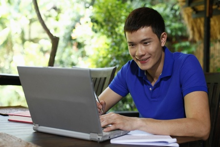 revising: Man using laptop