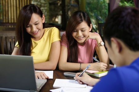 revising: Man and women studying together Stock Photo
