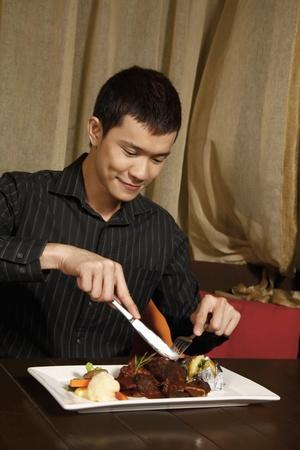 Man enjoying his meal photo