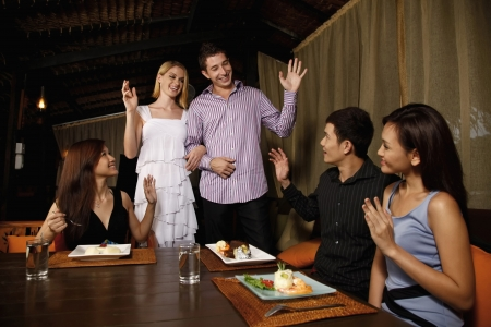restaurant setting: Friends meeting up at a restaurant while enjoying dinner