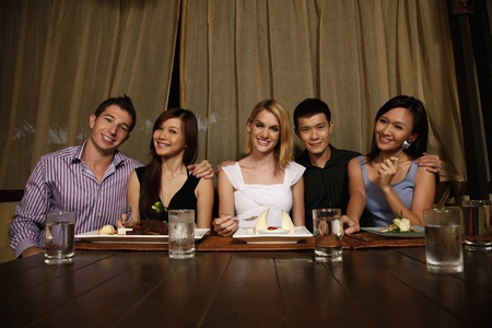 Friends enjoying dinner at a restaurant Stock Photo - 8536604