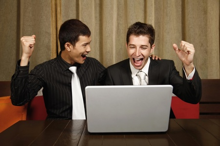 Businessmen cheering with arms raised Stock Photo - 8536974