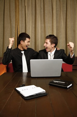 Businessmen cheering with arms raised Stock Photo - 8536860