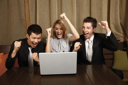 Business people cheering with arms raised Stock Photo - 8536786