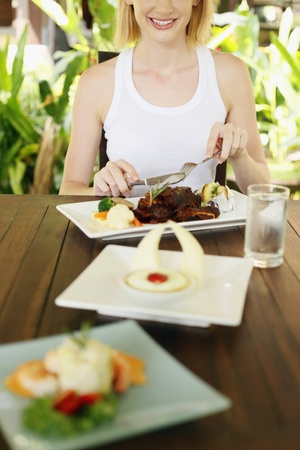 Woman enjoying her food Stock Photo - 8536755