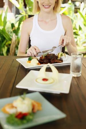 Woman enjoying her food Stock Photo - 8536755