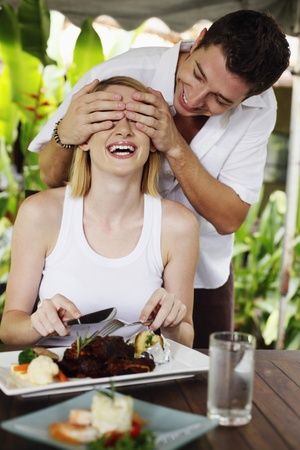 Man covering woman's eyes Stock Photo - 8536634