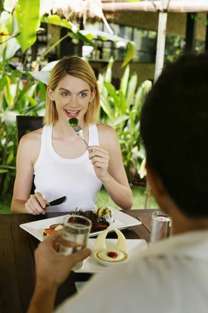 Man and woman eating at a cafe photo