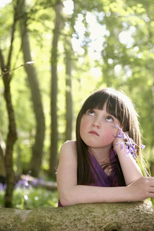 Girl looking up thinking Stock Photo - 8606114
