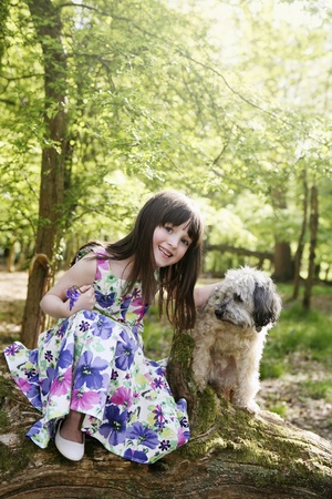 Girl with her pet dog photo