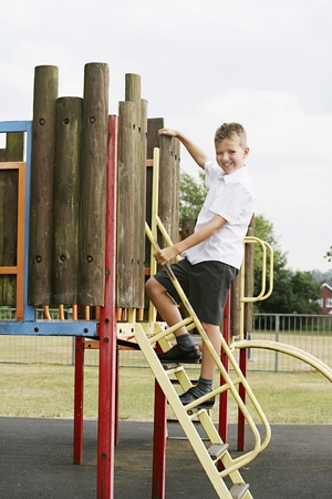 Boy climbing up slide Stock Photo - 8606153