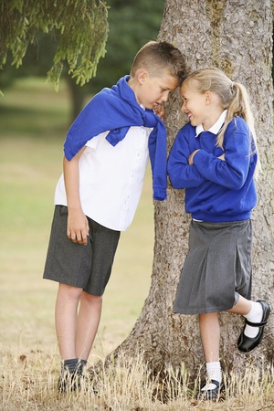 school uniform girl: Boy and girl looking at each other smiling