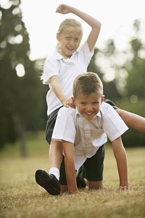 full uniform: Boy and girl having fun in the park