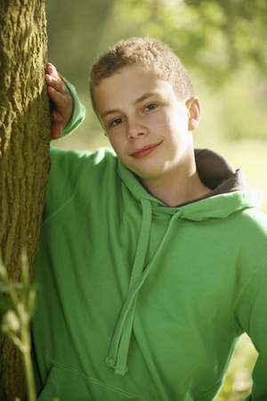 Boy standing next to a tree Stock Photo - 8606129