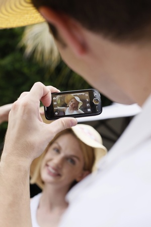 Man taking picture, woman posing Stock Photo - 8606011