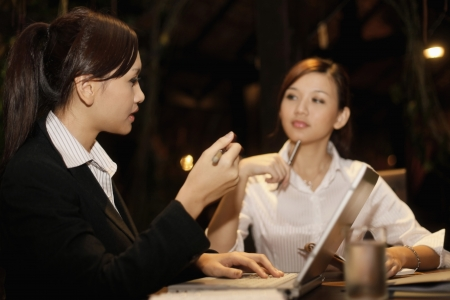 serious meeting: Businesswomen having discussion at a cafe