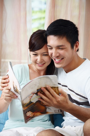 Man and woman reading magazine Stock Photo - 8606061