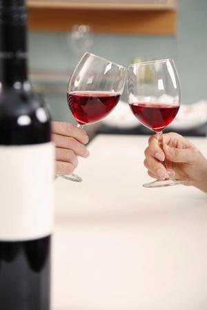Man and woman toasting wine photo