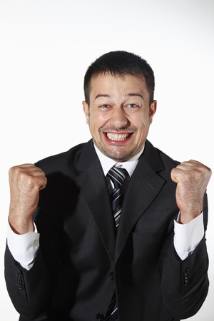 jubilating: Businessman punching fist in the air Stock Photo
