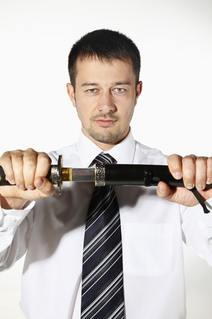 Businessman pulling out sword Stock Photo - 8605986