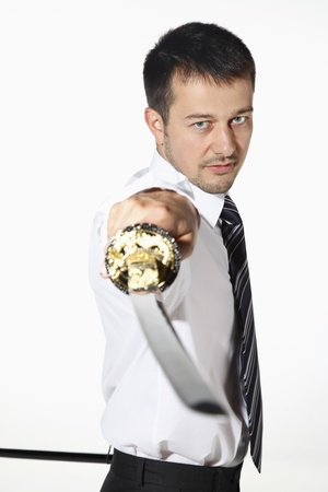Businessman with sword photo
