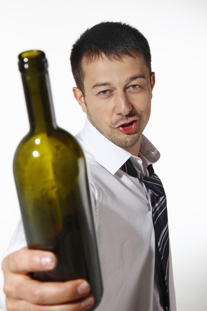Drunk businessman holding an empty bottle photo