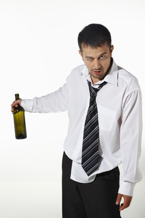 Drunk businessman with an empty bottle Stock Photo