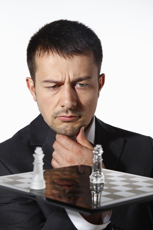 Businessman playing chess game photo