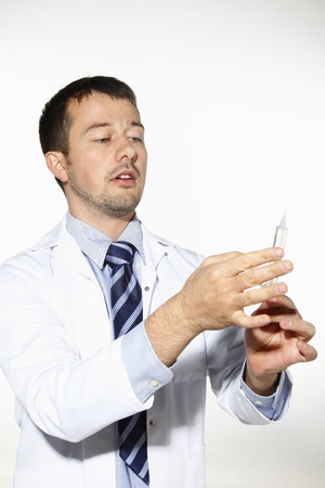 Doctor preparing syringe photo